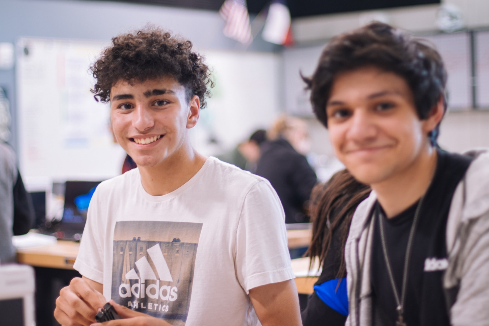 Teenage boys smiling in classroom
